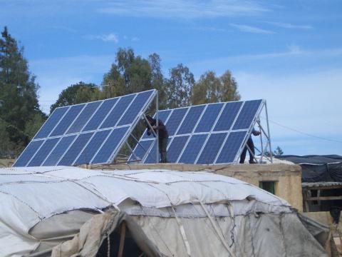 Solar Panels being installed in Um El Kheir.  Photo by COMET.