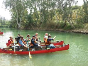 Enjoying the recreational value that a clean stretch of the Jordan River can offer